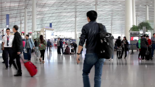people with luggage walking in airport - carry on luggage stock videos and b-roll footage