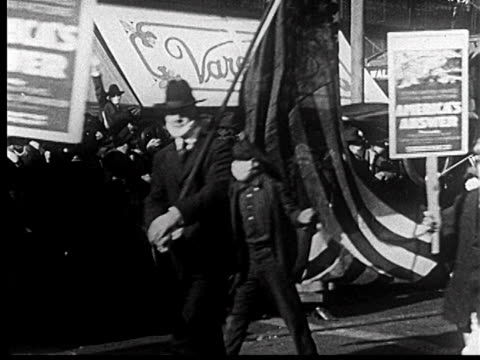b/w 1918 people with masks to prevent spanish flu flags marching in liberty loan parade / newsreel - 1918 stock videos & royalty-free footage