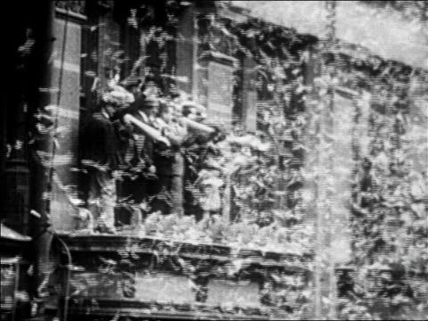b/w 1927 people with megaphones stand on windowsills in ticker tape parade for lindbergh / newsreel - 1927 stock videos & royalty-free footage