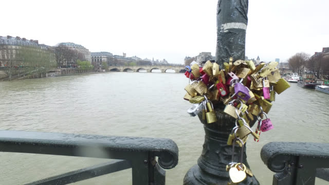 people with umbrellas at center of paris - river seine stock videos & royalty-free footage