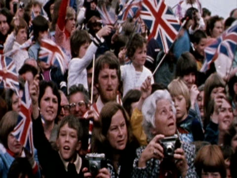 people with union-jack flags during queen silver jubilee tour of midlands, derby - number of people stock videos & royalty-free footage