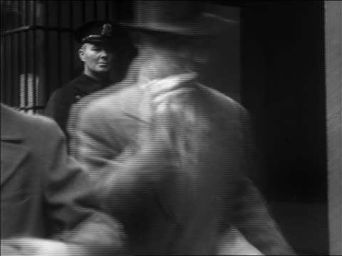 b/w 1933 people with wrapped bottles of liquor exiting liquor store past policeman - liquor store stock videos and b-roll footage