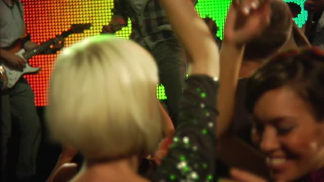 MS SLO MO People women dancing at rock concert / London, UK