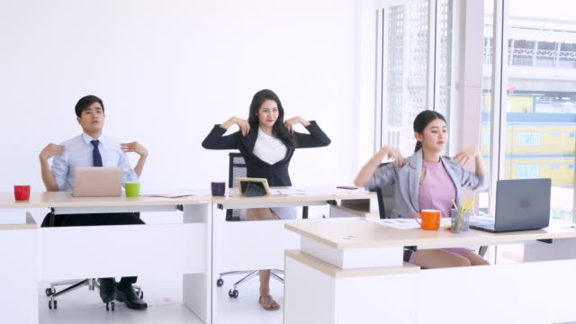 people work and exercise in office - warm up exercise stock videos & royalty-free footage