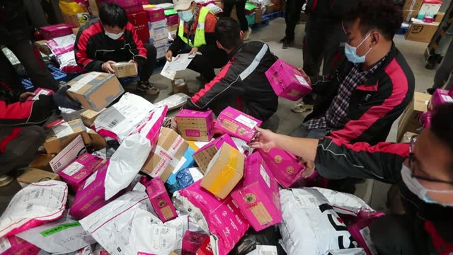 people work at a sf express branch on november 12, 2020 in kunming, yunnan province of china. november 11, also knows as singles' day, is the most... - online shopping stock videos & royalty-free footage