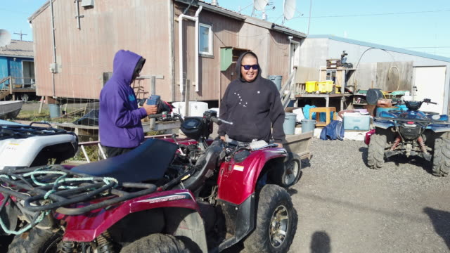 people work on an atv which is a necessary machine when living in the village to hunt or just get around on september 10, 2019 in kivalina, alaska.... - アラスカ点の映像素材/bロール