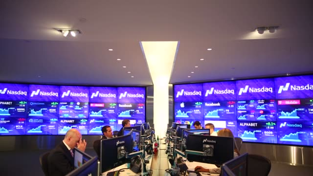 people work the market intelligence desk at nasdaq in new york, u.s., on thursday, august 18, 2016. shots: view of market intelligence desk as man... - ナスダック点の映像素材/bロール