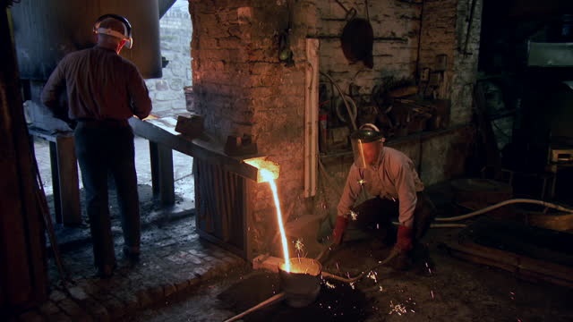 people work with molten metal at a boatyard, uk - metalwork stock videos & royalty-free footage
