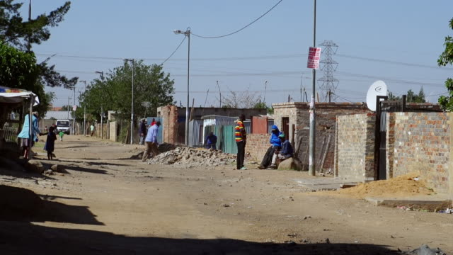 WS People working and walking in town street / Diepsloot, South Africa