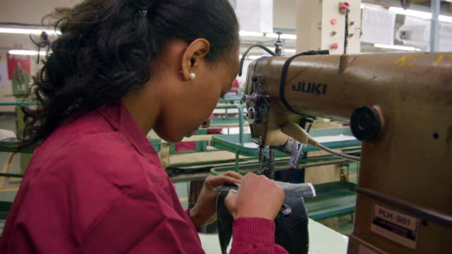 people working at a shoe factory - ethiopia stock videos & royalty-free footage