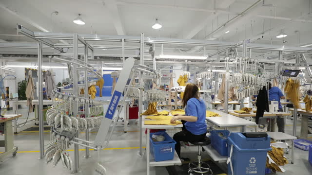 """people working at alibaba group holding ltd.'s smart factory known as xunxi, translated literally as """"fast rhino"""". china's largest corporation... - manufacturing occupation stock-videos und b-roll-filmmaterial"""