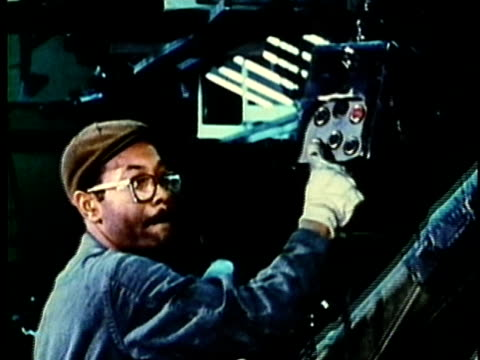 vidéos et rushes de montage, people working at car assembly line in factory, 1960's, detroit, michigan, usa - détroit michigan