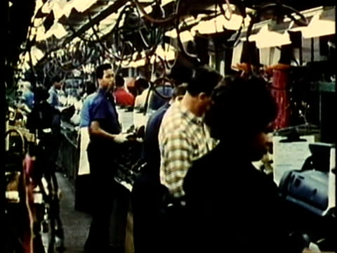 stockvideo's en b-roll-footage met montage, people working at car assembly line in factory, 1960's, detroit, michigan, usa - 1960 1969