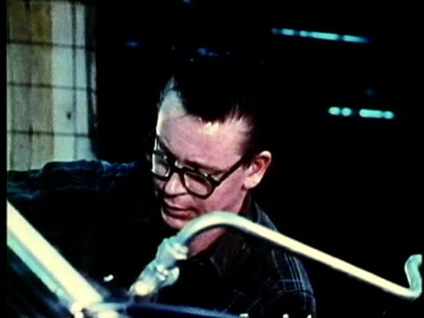 vidéos et rushes de montage, people working at car assembly line in factory, 1960's, detroit, michigan, usa - 1960 1969