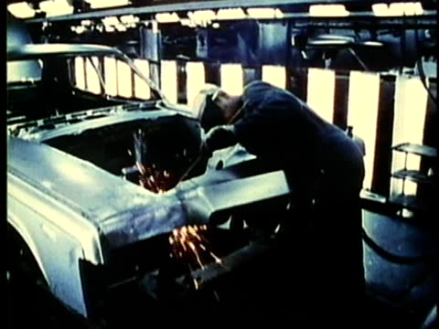 montage, people working at car assembly line in factory, 1960's, detroit, michigan, usa - 1960 1969 stock-videos und b-roll-filmmaterial
