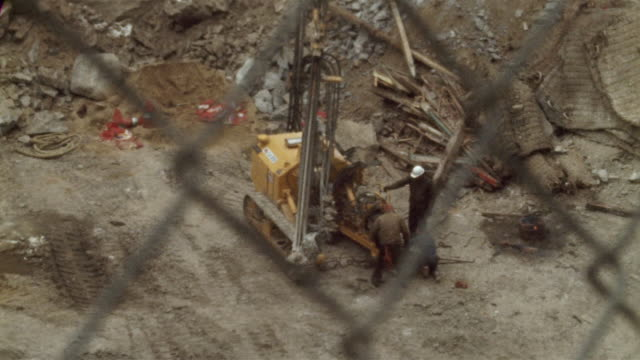 1978 montage ms ha td r/f selective focus people working at downtown construction site, new york city, new york state, usa - 1978 stock videos and b-roll footage