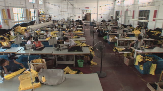 HA WS PAN People working at sewing machines in factory/ Shanghai, China