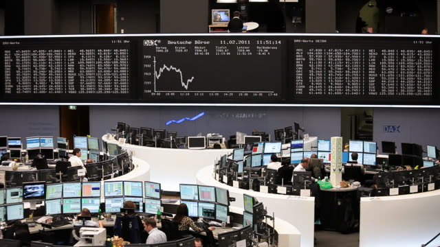 ms people working at stock exchange / frankfurt/main, hesse, germany - 株価点の映像素材/bロール