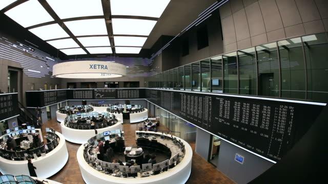ws pan  people working at stock exchange / frankfurt/main, hesse, germany - western script stock videos & royalty-free footage