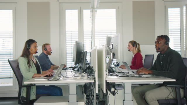 people working in a call center - desk stock videos & royalty-free footage