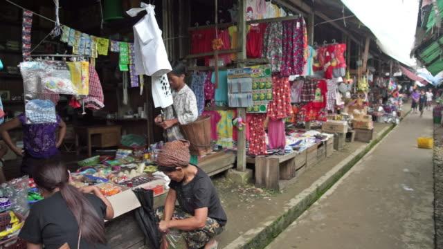 People working in a market in Yangon, Myanmar