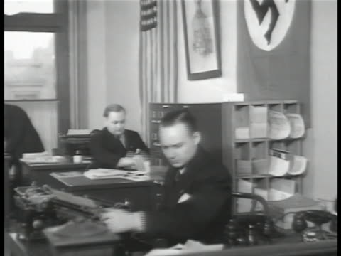 people working in german-american bund office. pro-nazi bund members in uniform standing in line. vs members singing german military song containing... - northern european stock videos & royalty-free footage