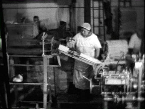 1938 b/w montage people working in margarine factory / east prussia, germany - east germany stock videos and b-roll footage