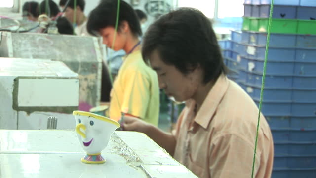 CU, R/F, People working in toy factory, Dongguan City, China