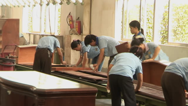 MS PAN People working on furniture factory assembly line/ Dongguan, China