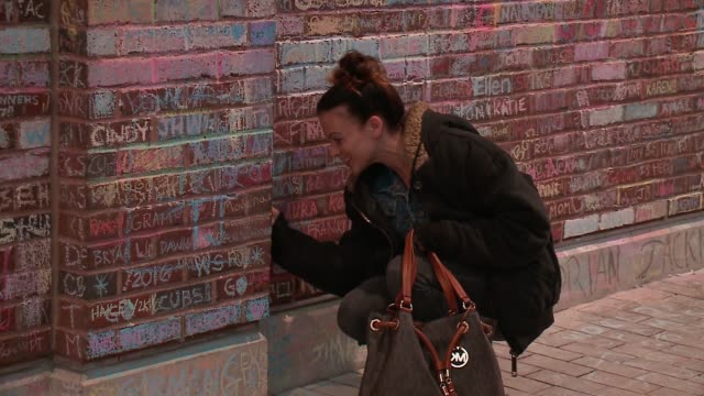 WGN People Write Messages in Chalk on Wrigley Field Brick Wall After World Series WIn on Nov 9 2016