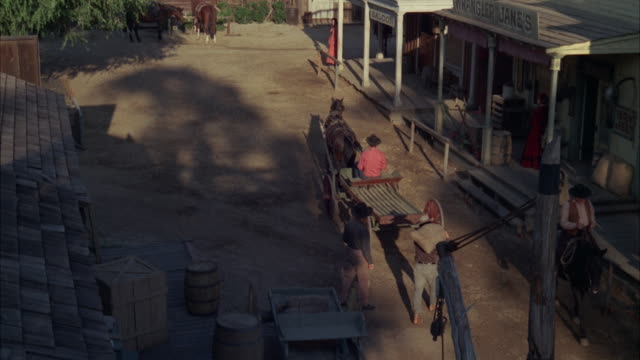 vídeos de stock, filmes e b-roll de ms people's activity in small old west town / unspecified   - animal de trabalho