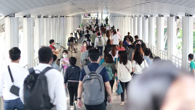 people's commute to work during the covid-19 or the coronavirus outbreak everyone still wears masks to prevent the virus. prevent the spread - editorial stock videos & royalty-free footage