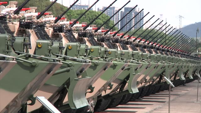 People's Liberation Army military vehicles sit in a row after a visit by Chinese President Xi Jinping at the Shek Kong Barracks in Hong Kong China on...