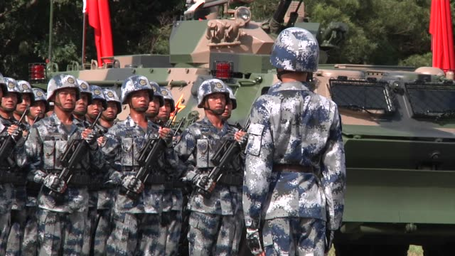 people's liberation army troops march and stand in formation after a visit by chinese president xi jinping at the shek kong barracks in hong kong... - military parade stock videos & royalty-free footage