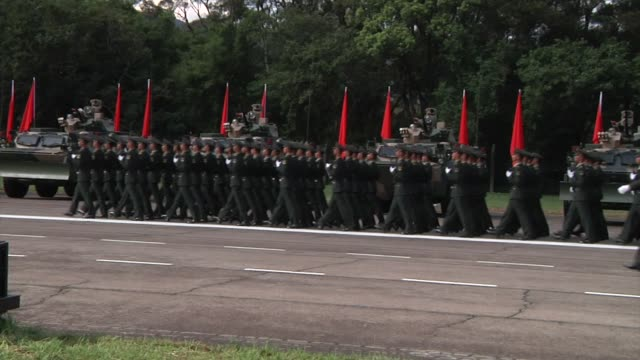 People's Liberation Army troops march in formation during a visit by Chinese President Xi Jinping at the Shek Kong Barracks in Hong Kong China on...