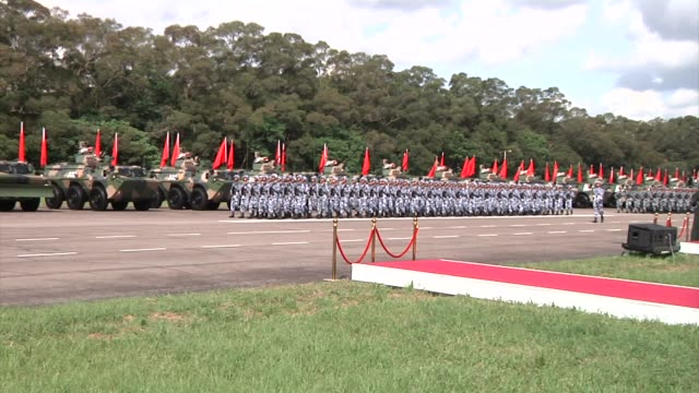 People's Liberation Army troops march in formation during a visit by Chinese President Xi Jinping not pictured at the Shek Kong Barracks in Hong Kong...