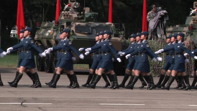 People's Liberation Army troops march in formation followed by Female People's Liberation Army troops during a visit by Chinese President Xi Jinping...