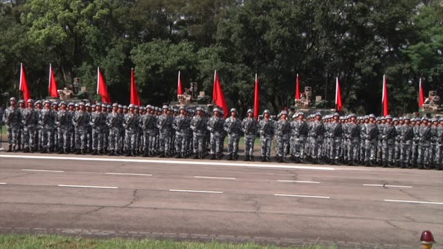 People's Liberation Army troops stand in formation during a visit by Chinese President Xi Jinping not pictured at the Shek Kong Barracks in Hong Kong...