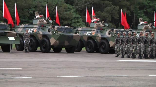 People's Liberation Army troops stand in formation during a visit by Chinese President Xi Jinping at the Shek Kong Barracks in Hong Kong China on...