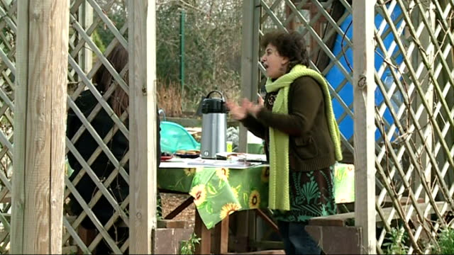 stockvideo's en b-roll-footage met people's millions competition launched england london tottenham ext welcome sign on community allotment tilt down leyla laksari chatting with alison... - gazebo