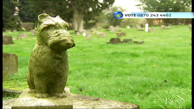 ITV People's Millions competition Sign above entrance to cemetery 'They are ever in our thoughts Love never dies' Stone statue of dog Headstone for...