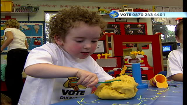 ITV People's Millions Ducklings playgroup and St Anne's Garden in Soho INT Children playing with playdough