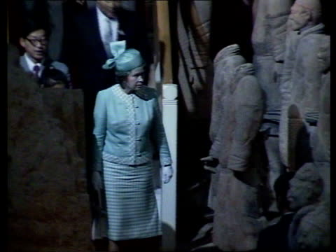'A People's Welcome' The Queen in China 'A People's Welcome' The Queen in China Men after greeting Queen relax on steps by chatting and smoking Queen...
