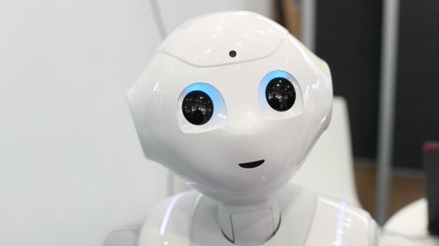 pepper humanoid robot, developed by softbank group corp., operates in an exhibition hall at the cebit 2017 tech fair in hannover, germany, on... - 製造用機械点の映像素材/bロール