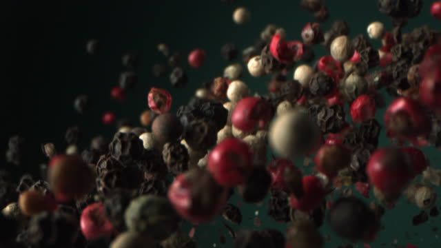 vídeos y material grabado en eventos de stock de pepper is flying in the air in high speed on green aqua menthe color background shot at 1000 fps 4k - ingrediente