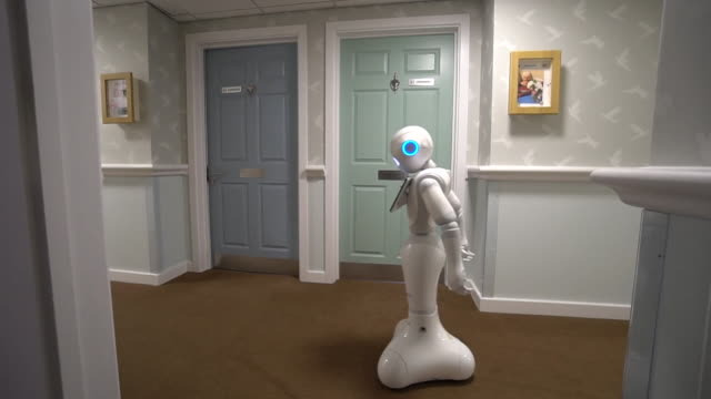 pepper, the culturally aware robot, being used in bedfordshire care home to see if she can improve the mental health of residents - technology stock videos & royalty-free footage