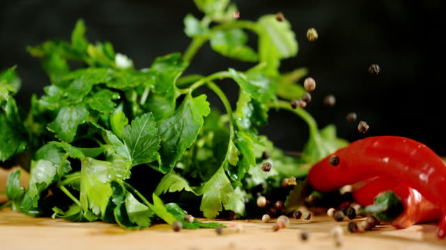 slo mo peppercorns falling on vegetables - parsley stock videos and b-roll footage