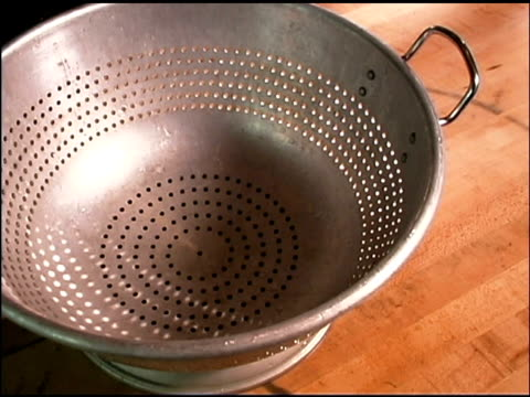 peppers falling into colander - medium group of objects stock videos & royalty-free footage