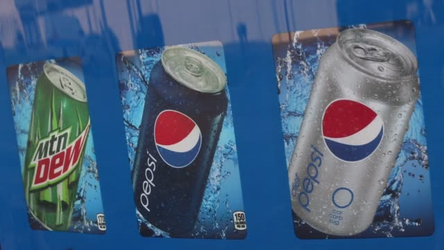 A PepsiCo Inc soda vending machine stands outside a shopping center in Jasper Indiana US on Friday April 17 2015 Shots Close up shot of the Pepsi...