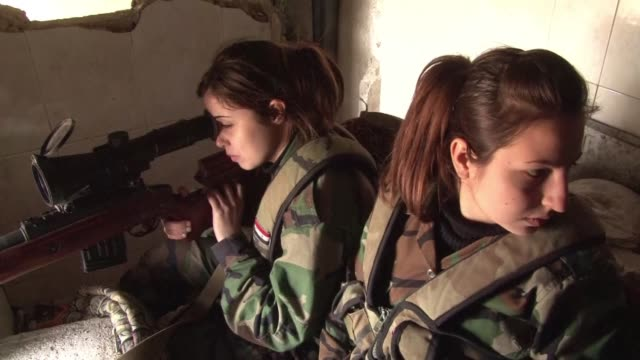 perched on a makeshift bench taking turns with a sniper rifle the syrian armys top markswomen await their prey on the front line in east damascus - resourceful stock videos & royalty-free footage